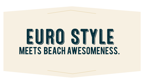 Euro Style Meets Beach Awesomeness - Chelsea at Juanita Village Logo | Studio, 1 & 2 Bedroom Apartments for Rent | Kirkland, WA 98034
